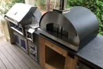 Hestan Grill Fontana Forni with wood storage and Perlick refrigerator